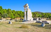 stock photo of epidavros  - The ruins of the Temple of Asclepius surrounded by coniferous forest Epidaurus Greece - JPG