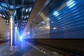 image of passenger train  - High speed passenger train on tracks with motion blur effect at night - JPG