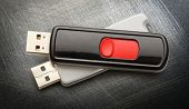 picture of flashing  - Usb flash drives on the metal background - JPG