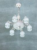 stock photo of chandelier  - Old chandelier is hanging on the ceiling of hotel - JPG