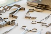 stock photo of surgical instruments  - surgical instruments and tools including scalpels forceps and tweezers arranged on a table for a surgery - JPG