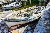 stock photo of old boat  - Old white wooden boat in Perast Montenegro - JPG
