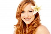 image of white lily  - Young woman with white lily flower in her hair over white - JPG