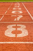 foto of 8-track  - running track with number at finish point - JPG