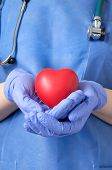 picture of heart surgery  - Female doctor holding a red heart shape - JPG