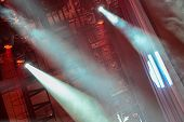 foto of soffit  - Concert spotlights shining red light and fog - JPG