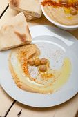 stock photo of pita  - traditional chickpeas Hummus with pita bread and paprika on top - JPG