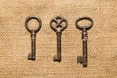 pic of hasp  - Three vintage keys to the safe on old cloth - JPG