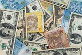 stock photo of depreciation  - Background banknotes of us dollars and Ukrainian hryvnia - JPG