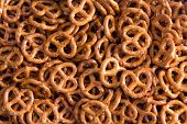 picture of pretzels  - Background texture of salted savory mini pretzels in the traditional looped knot shape in a random heap viewed full frame from overhead - JPG