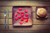 picture of bread rolls  - A wooden place set with love hearts and a bread roll  - JPG