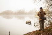 picture of fisherman  - Fisherman on the river  - JPG