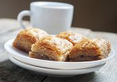 image of baklava  - baklava close up in white plate with coffee - JPG