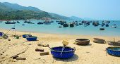 image of coracle  - Picturesque sea landscape with tribal boats on beautiful beach - JPG