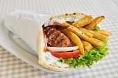 foto of sandwich wrap  - chicken or pork wrap sandwich on white plate - JPG