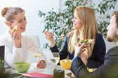 pic of lunch  - Young people eating lunch during break in office - JPG