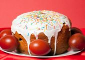 picture of no clothes  - Easter cake and painted eggs on red cloth closeup - JPG