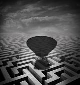 image of overcoming obstacles  - Overcome obstacles concept as a hot air balloon cast shadow on a maze or labyrinth as a motivational business metaphor for rising above challenges incorporating innovative solutions - JPG