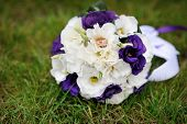 pic of bridal veil  - bridal bouquet lying on the green grass - JPG