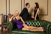 image of threesome  - A guy and two girls in the room - JPG