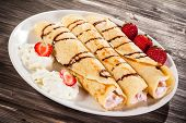 foto of crepes  - Crepes with strawberries and cream - JPG