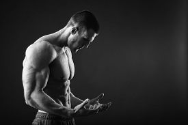 stock photo of macho man  - Muscular man bodybuilder - JPG