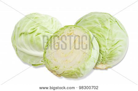 Three Heads Of Cabbage On A Light Background