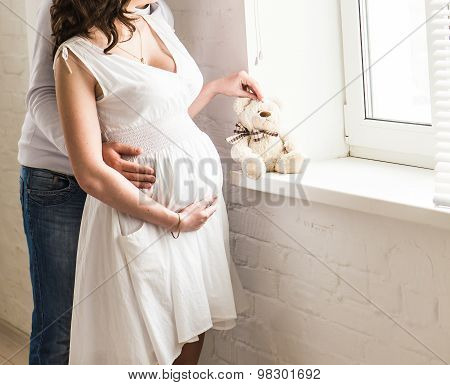 Beautiful pregnant woman with her husband