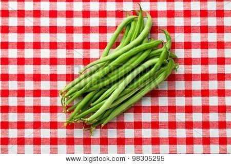 green beans on checkered tablecloth