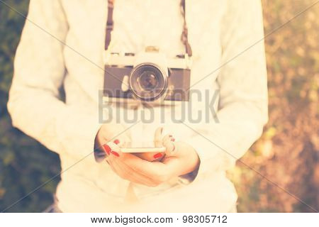 Girl With Cell Phone And Old Camera, Vintage Color Effect