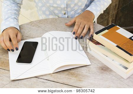 Girl With Books, Cell Phone And Diary