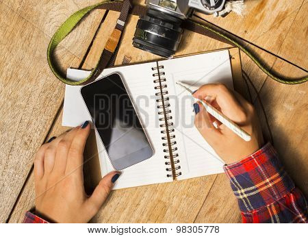Girl With Blank Cell Phone, Diary And Old Camera