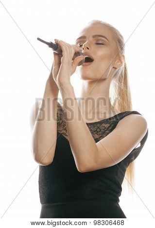 young pretty blond woman singing in microphone isolated