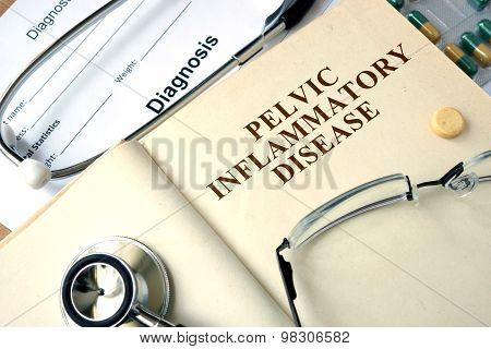 Word Pelvic inflammatory disease (PID)  on a paper and pills.