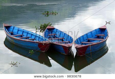 Blue boats on a lake