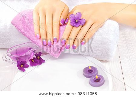 french manicure with violet flowers. spa