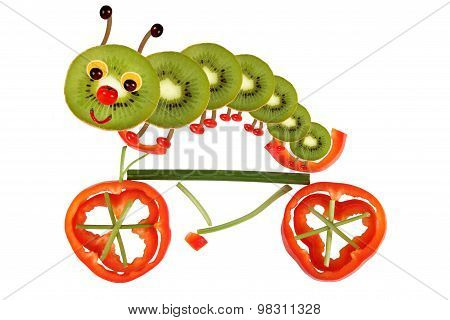 Creative Food Concept. Funny Little Caterpillar On A Bicycle