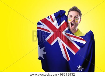Fan holding the flag of Australia on red background