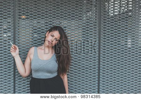 Beautiful Curvy Girl Smoking A Cigarette In An Urban Context