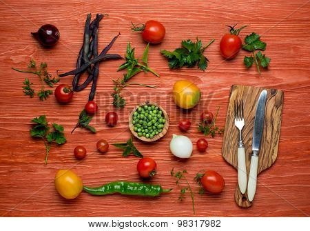 Fresh Organic Vegetables on a White Plate with Knife and Fork.   Horisontal Composition