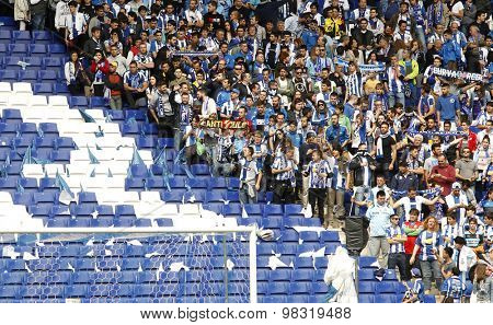 BARCELONA - APRIL, 25: Group of supporters of Espanyol leave empty seats during a Spanish League match against FC Barcelona at the Estadi Cornella on April 25, 2015 in Barcelona, Spain