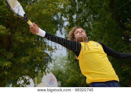 MOSCOW, RUSSIA - JULY 18, 2015: Vinicius Font of Brazil in the semifinal match of the ITF Beach Tennis World Team Championship against Russia. Russia won the match 2-1