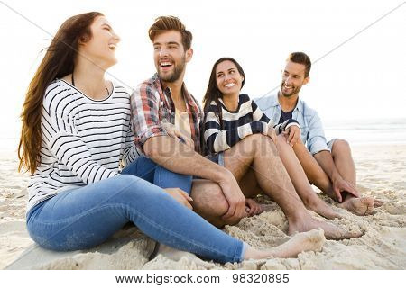 Multicultural group of friends at the beach having fun