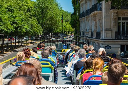 Tourists Enjoy Sightseeing Tour On A Bus