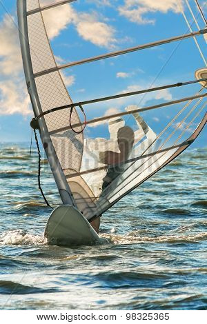 Windsurfing On The Background Of Sea And Sky