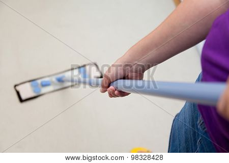 Woman Mopping The Floor