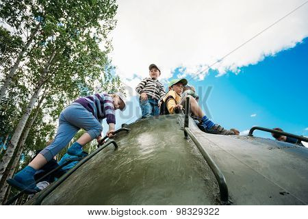 Children climb on Soviet tank from World War II during celebrati