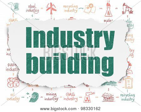 Manufacuring concept: Industry Building on Torn Paper background