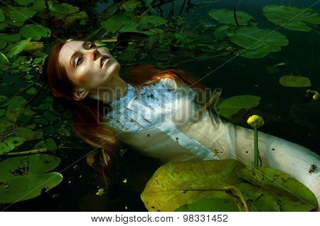 Tender Young Woman Swimming In The Pond Amon Water Lilies