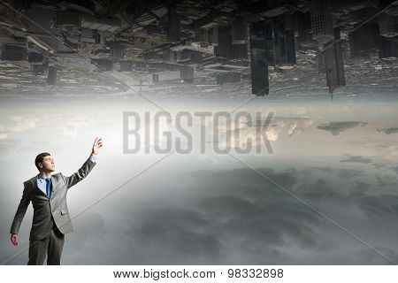 Businessman reaching arm